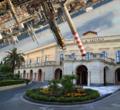 Scuola Superiore di Catania con sopra rovesciate le raffinerie di Priolo Gargallo.png